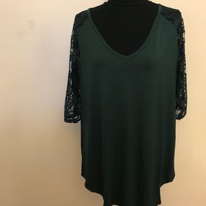 Green shirt with lace sleeves
